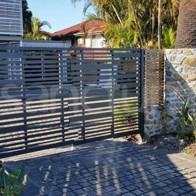 Slatted decorative feature gate