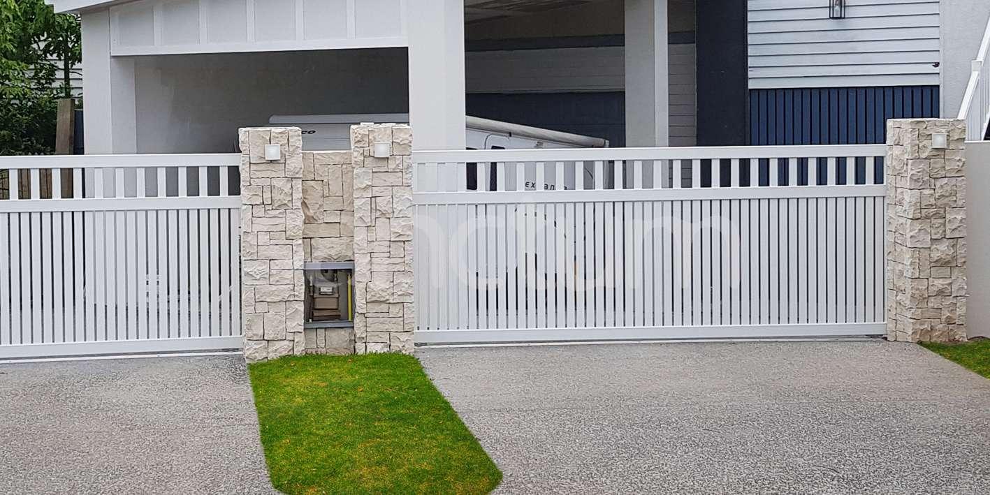 White slatted vehicle driveway gate